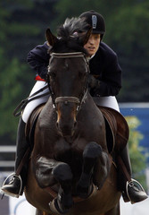Schoneborn of Germany competes in horse riding competition in women's individual modern pentathlon world championships in Budapest