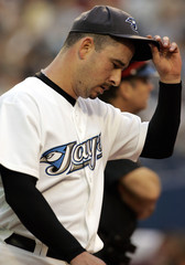 Blue Jays pitcher Miller walks off the field after first inning against the Mariners.