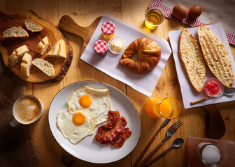 Continental breakfast croissant eggs bacon bread