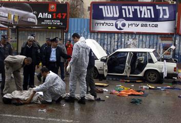 ISRAELI POLICE TAKE FINGERPRINTS FROM DEAD PALESTINIAN AFTER HE WASSHOT ON A MAIN STREET IN RAMAT GAN.