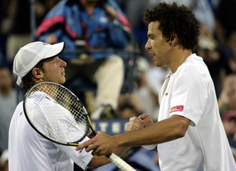 NALBANDIAN IS CONGRATULATED BY EL AYNAOUI AFTER US OPEN QUARTERFINAL.