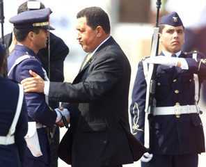 PRESIDENT HUGO CHAVEZ WITH HONOUR GUARD IN LIMA.