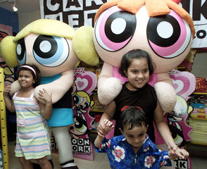 INDIAN CHILDREN PLAY WITH POWERPUFF GIRLS CHARACTERS IN NEW DELHI.