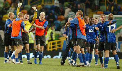 Halmstad players celebrate their victory over Sporting Lisbon during their UEFA Cup match in Lisbon