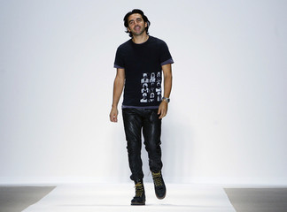 Designer Yigal Azrouel walks after showing his Fall 2009 collection during New York Fashion Week
