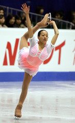 Fifteen-year-old Japanese Asada performs during women's singles free skating at ISU Figure Skating Grand Prix Final in Tokyo