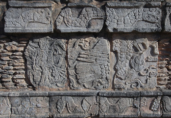 Reliefs on the walls in Chichen Itza