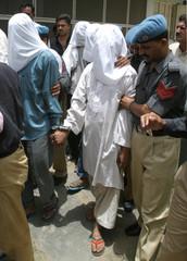 PAKISTANI POLICE ESCORT ISLAMIC MILITANTS TO A COURT IN KARACHI.