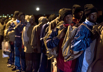Would-be immigrants stand in line at the port of Los Abrigos on Spain's Canary island of Tenerife