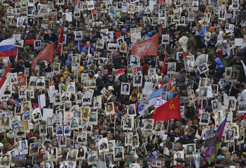 People carry pictures of World War Two soldiers as they take part in Immortal Regiment march during tVictory Day celebrations, marking 72nd anniversary of victory over Nazi Germany in World War Two, in central St. Petersburg