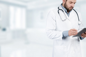 Doctor with stethoscope and digital tablet