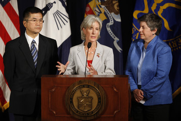 Sebelius speaks about the flu season alongside Locke and Napolitano at the Commerce Department in Washington