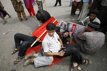 Activists wait for a rally to start during a half-day general strike called by the NCPOGMRPP in Dhaka.