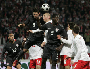 U.S. Dempsey fights for ball with Poland's Lewandowski during their friendly soccer match in Krakow