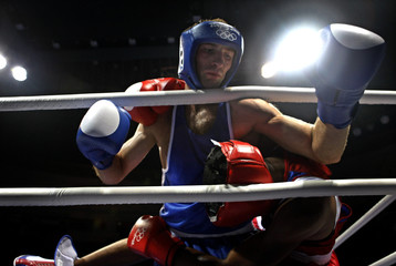 Andrade of the U.S. fights Jvania of Georgia during their men's welterweight (69kg) round of 32 boxing match at the Beijing 2008 Olympic Games