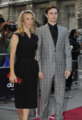 British artist Sam Taylor Wood and boyfriend Aaron Johnson arrive for the GQ Men of the Year Awards in central London