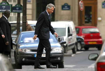 French Prime Minister Dominique de Villepin crosses a street as he leaves the National Assembly in P..
