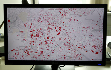 A computer screen shows Aleppo's destruction projected on a Berlin map, in the office of data visualiser Hans Hack in Berlin