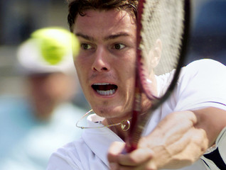 Marat Safin of Russia returns a shot to [American Todd Martin] during their semifinal match at the U..