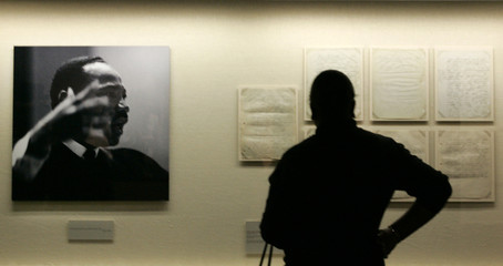 A patron looks over papers at the Morehouse College Martin Luther King, Jr. collection at the Atlanta History Center which opened on the King Holiday in Atlanta.
