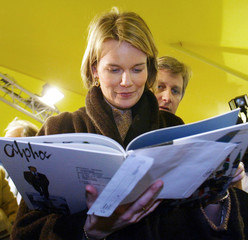 Belgian Princess Mathilde reads a comic strip at the Cartoon Festival in Angouleme, January 23, 2003..