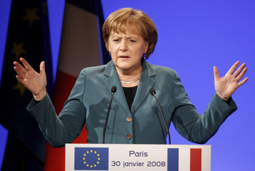 German Chancellor Merkel delivers a speech during the European meeting organised by the UMP political party in Paris