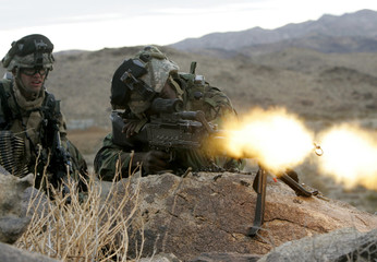US Army soldiers fire machine gun shooting blanks and laser at Fort Irwin