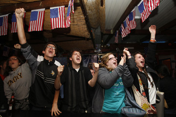Supporters of U.S. President-elect Senator Obama cheer as they monitor results of U.S. presidential election in Jerusalem