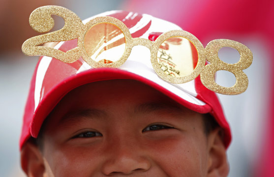 A spectator wears an olympic hat at the US-Canada baseball game during their men's preliminaries baseball competition at the Beijing 2008 Olympic Games