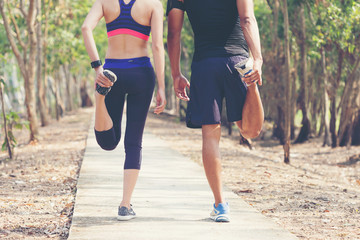 Couple warm body before jogging and running outdoors in the morning