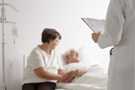 Supporting wife listening doctor's diagnosis