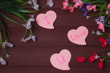 Card with Message Love You on the Letter on wooden background