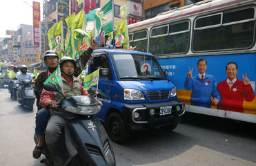 SUPPORTERS OF TAIWANESE PRESIDENT CHEN SHUI-BIAN RIDES ON MOTOCYCLE IN KAOHSIUNG.