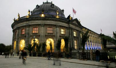 People walk past the Bode Museum in Berlin
