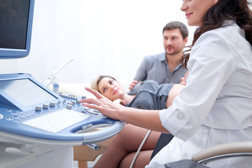 Cropped shot of a female doctor performing ultrasound scanning for her pregnant patient copyspace couple on the background examination diagnosis medical procedure technology health pregnancy.