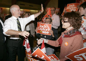 New Democratic Party (NDP) leader Jack Layton waves to supporters during a campaign rally in Toronto
