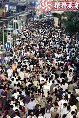 CHINESE REVELLERS FLOCK SHANGHAI'S NANJING ROAD ON NATIONAL DAY.