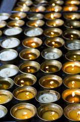Candles burning in the Chimi Lhakhang monastery, Bhutan