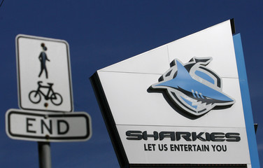 A street sign is seen next to the logo of the Rugby League team 'Sharks' in south Sydney