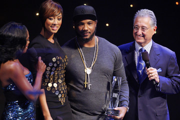 Polow da Don holds his award for producer of the year in New York
