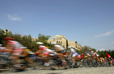 Riders competing in the women's Olympic cycling road race pass the ancient Acropolis.