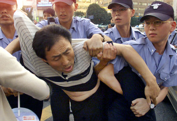 SOUTH KOREAN POLICE ARREST A PROTESTER IN SEOUL.