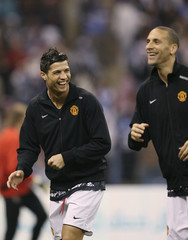 Manchester United's Cristiano Ronaldo and Rio Ferdinand warm up before their match against Al Hilal at King Fahed international stadium in Riyadh