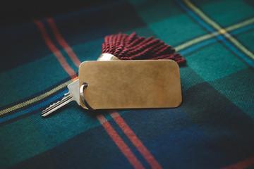 Scottish wedding prop, Tassel key tag on tartan kilt background