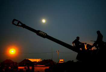 Israeli 155mm mobile artillery piece prepares to fire at Gaza from Nahal Oz at the border of Israel and Gaza strip