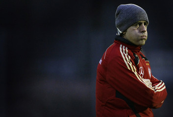 Coach Loew of Germany's national soccer team frowns during a practice session in Frankfurt