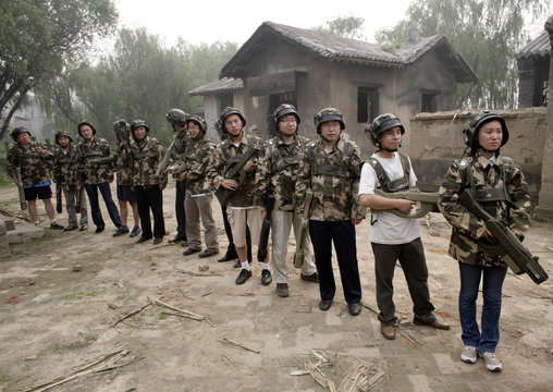 """Customers of Xuelang Outdoor Sports Club prepare laser guns for a """"Counter-Strike"""" game in Beijing"""
