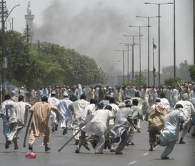 PAKISTANI PROTESTERS RUN DURING CLASHES WITH POLICE IN KARACHI.