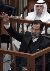 Saddam Hussein testifies during his genocide trial inside the fortified Green Zone in Baghdad