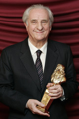 """Michel Aumont poses with his award during the French theatre award ceremony """"Les Molieres"""" in Paris"""